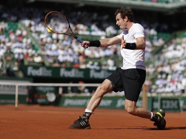 Andy Murray plays a backhand stroke during the French Open semi-final against Novak Djokovic at Roland Garros on June 5, 2015