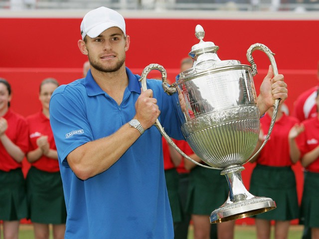 Andy Roddick of the U.S. holds up the trophy after winning the final match against Ivo Karlovic of Croatia at the Stella Artois Tennis Championships at the Queen's Club June 12, 2005