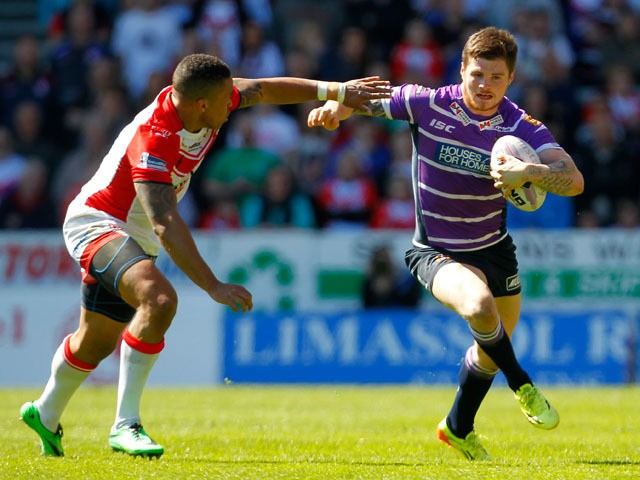 Darrell Goulding of Wigan in action with Jordan Turner of St Helens during the Super League match between St Helens and Wigan Warriors at Langtree Park on April 18, 2014