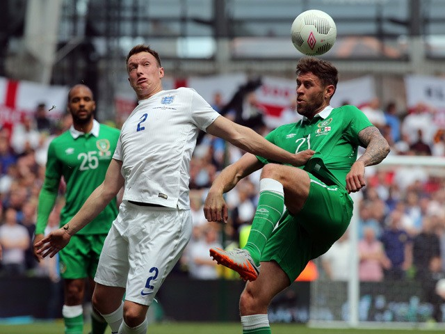 England's defender Phil Jones vies with Republic of Ireland's striker Daryl Murphy during the international friendly football match between Republic of Ireland and England at Aviva Stadium in Dublin on June 7, 2015