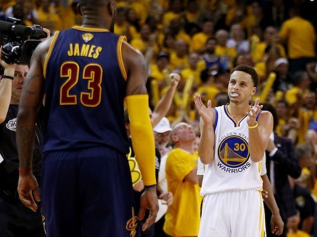 LeBron James and Stephen Curry during game one of the NBA Finals between the Golden State Warriors and Cleveland Cavaliers on June 4, 2015