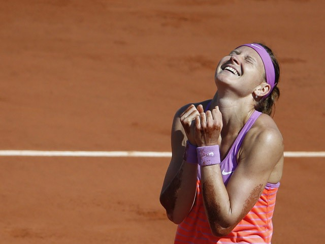 Czech Republic's Lucie Safarova celebrates after winning her match against Serbia's Ana Ivanovic during their women's semi-final match of the Roland Garros 2015 French Tennis Open in Paris on June 4, 2015