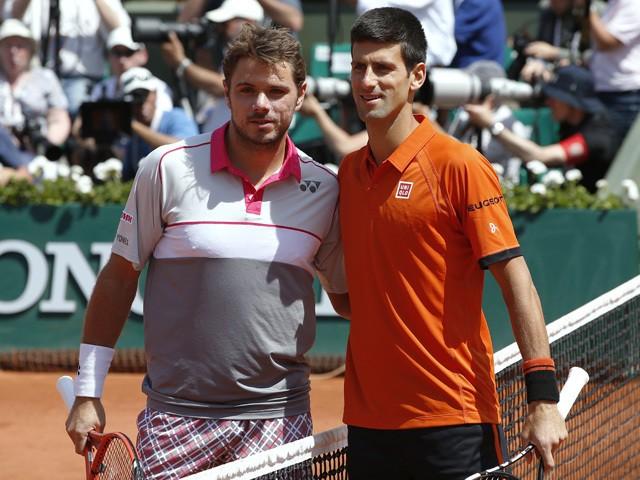 Serbia's Novak Djokovic and Switzerland's Stanislas Wawrinka pose before the men's final match of the Roland Garros 2015 French Tennis Open in Paris on June 7, 2015