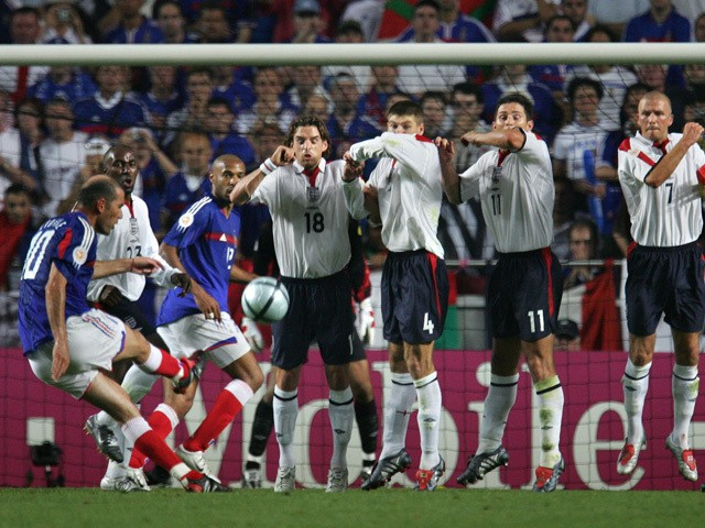 French captain Zinedine Zidane (L) scores France's equaliser against England during their opening match at the European Nations football championships at the Estadio da Luz in Lisbon on 13 June 2004