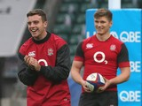 George Ford (L) looks on with Owen Farrell during the England captain's run at Twickenham Stadium on November 21, 2014