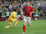 Wayne Rooney of England celebrates after scoring their third goal during the UEFA Euro 2004, Group B match between Croatia and England at the Luz Stadium on June 21, 2004