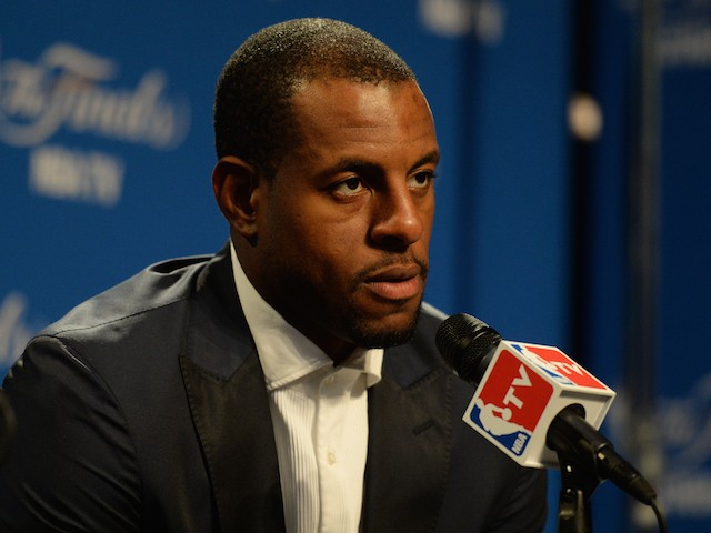 Andre Iguodala #9 of the Golden State Warriors spwaks in overtime the media after Game Four of the 2015 NBA Finals against the Cleveland Cavaliers at Quicken Loans Arena on June 11, 2015