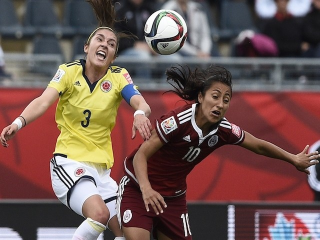 Colombia's midfielder Catalina Usme (L) vies with Mexico's defender Christina Murillo during a Group F match at the 2015 FIFA Women's World Cup between Colombia and Mexico at Moncton Stadium in Moncton, New Brunswick on June 9, 2015