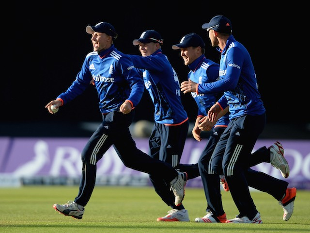 Joe Root of England celebrates with Sam Billings, Jason Roy and Alex Hales after catching out Kane Williamson of New Zealand during the 1st ODI Royal London One-Day match between England and New Zealand at Edgbaston on June 9, 2015