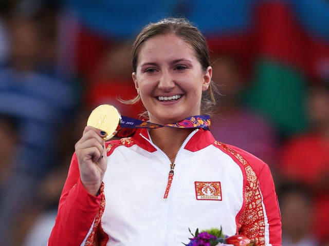 Gold medalist Irina Zaretska of Azerbaijan celebrates during the medal ceremony for Women's Karate Kumite -68kg on day two of the Baku 2015 European Games at Crystal Hall on June 14, 2015