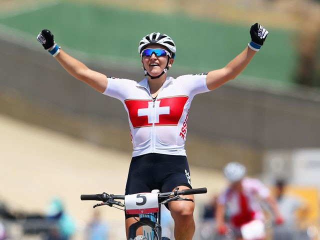Kathrin Stirnemann of Switzerland celebrates as she crosses the line to win silver in the Women's Cross-country Mountain Bike Cycling during day one of the Baku 2015 European Games at Mountain Bike Velopark on June 13, 2015