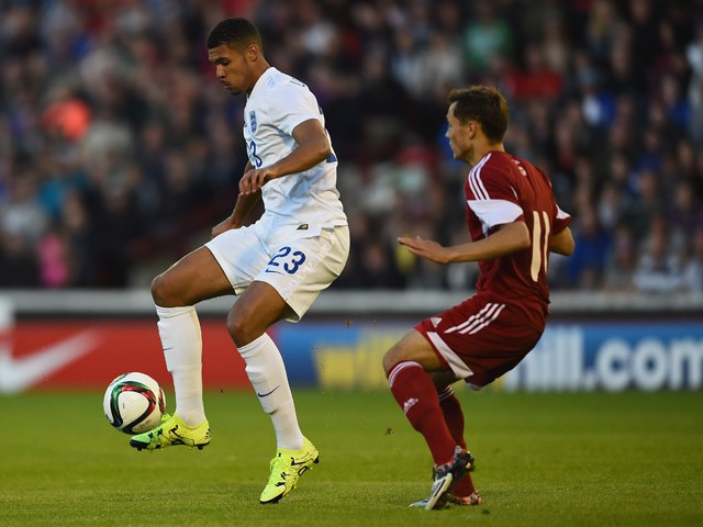 Ruben Loftus-Cheek of England battles with Yaraslau Yarotski of Belarus during the International Match between England U21 and Belarus U21 at Oakwell Stadium on June 11, 2015