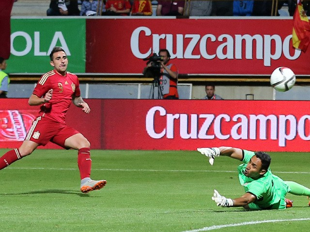 Spain's forward Paco Alcacer shoots against Costa Rica's goalkeeper Keilor Navas to score a goal during the friendly football match Spain vs Costa Rica at the Reino de Leon stadium in Leon on June 11, 2015