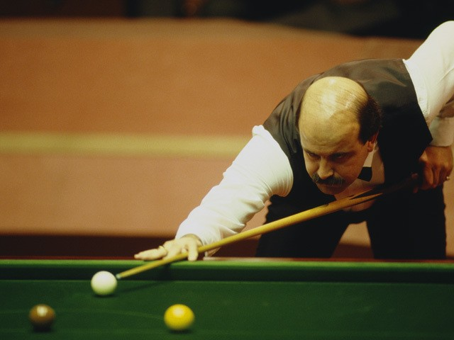 English snooker player Willie Thorne competing in the World Snooker Championship at the Crucible Theatre, Sheffield, 1988