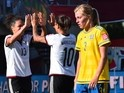 Germany's Celia Sasic (L) and Dzsenifer Marozsan (C) celebrate their win as Sweden's Linda Sembrant looks on during their 2015 FIFA Women's World Cup football round of 16 match between Sweden and Germany at Lansdowne Stadium in Ottawa, Ontario on June 20,