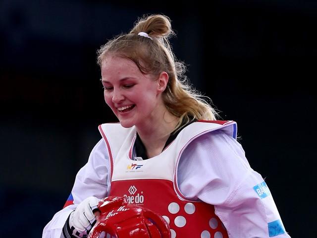 Gold medalist Anastasiia Baryshnikova of Russia celebrates victory over Farida Azizova of Azerbaijan after the Women's Taekwondo -67kg gold medal final on day six of the Baku 2015 European Games at the Crystal Hall on June 18, 2015