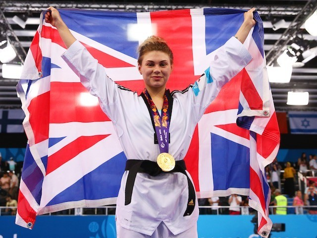 Team GB's taekwondo athlete Charlie Maddock poses with her gold medal earned at the European Games on June 16, 2015