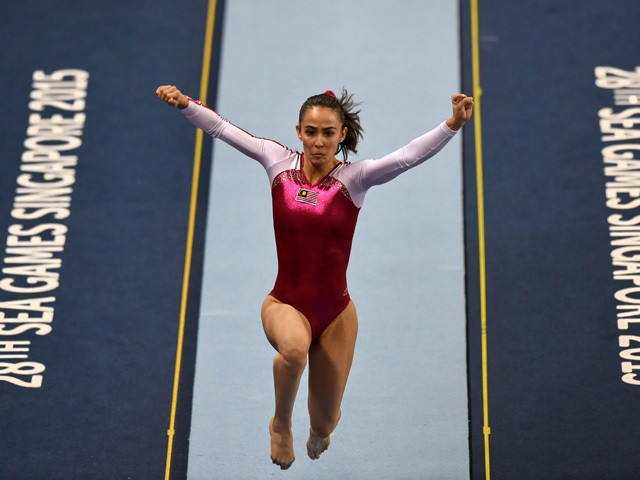 Malaysia's Farah Ann Abdul Hadi competes during the women's vault gymnastics final at the 28th Southeast Asian Games (SEA Games) in Singapore on June 9, 2015