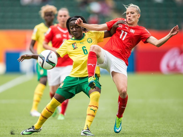 Cameroon's Francine Zouga (L) and Switzerland's Lara Dickenmann collide during their FIFA Women's World Cup group C match at Commonwealth Stadium in Edmonton, Canada on June 16, 2015