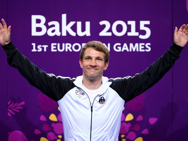 Gold medalist Henri Junghaenel of Germany celebrates priorto receiving the medal won in the Men's 50m Rifle Prone final during day six of the Baku 2015 European Games at the Baku Shooting Centre on June 18, 2015