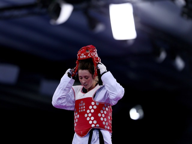 Team GB's Jade Jones removes her helmet following her victory in the preliminary rounds of the 2015 European Games in Baku