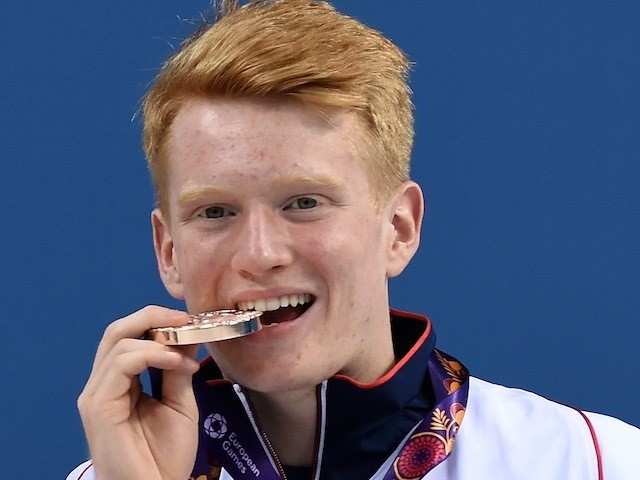 James Heatly poses with his medal after winning diving gold for Team GB at the European Games on June 18, 2015