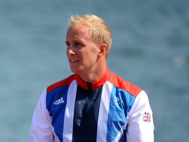 Jon Schofield of Great Britain celebrate during the medal ceremony for the Men's Kayak Double (K2) 200m Canoe Sprint on Day 15 of the London 2012 Olympic Games at Eton Dorney on August 11, 2012