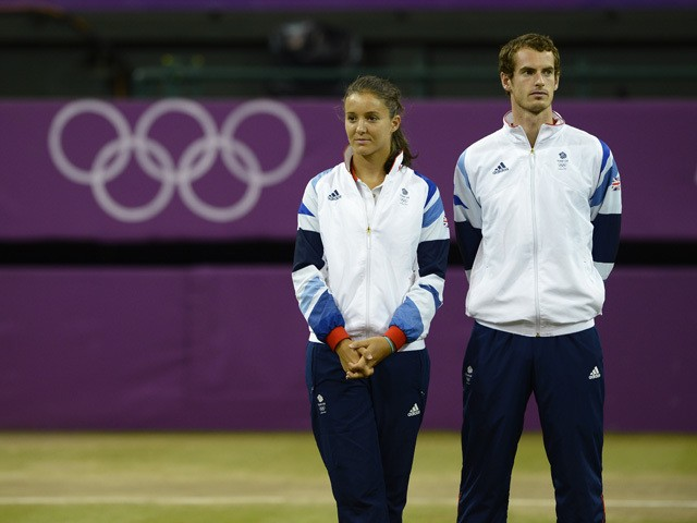 Great Britain's Laura Robson (L) and Andy Murray wait to receive their silver medals during a ceremony at the end of the London 2012 Olympic Games mixed doubles tennis tournament, at the All England Tennis Club in Wimbledon, southwest London, on August 5,