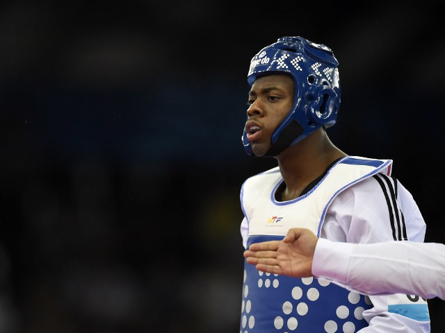 Lutalo Muhammad of Team GB reacts during his preliminary bout with Bulgaria's Teodor Georgiev at the European Games in Baku on June 18, 2015