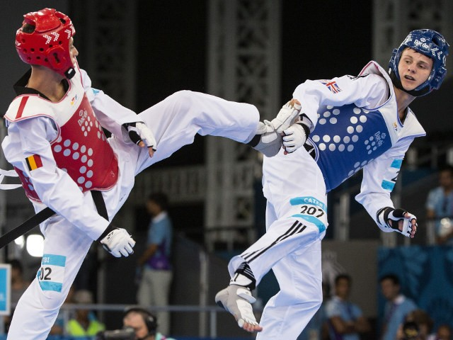 Team GB's Max Cater in action during his men's -58kg quarter-final bout against Si Mohamed Ketbi of Belgium at the European Games in Baku