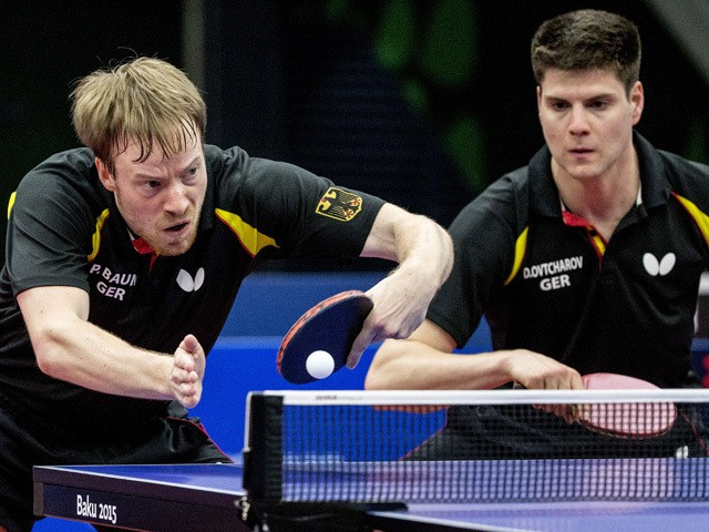 Germanys Patrick Baum (L) returns the ball towards Austrias Daniel Habesohn and Stefan Fegerl during the table tennis men's team bronze medal match Germany vs Austria at the 2015 European Games in Baku on June 15, 2015