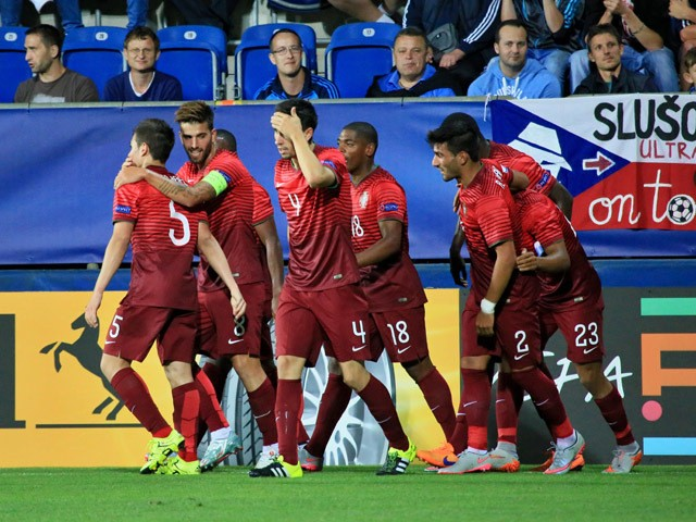 Portugal's players celebrate scoring during the UEFA Under21 European Championship 2015 football match between England and Portugal in Uherske Hradiste, Czech Republic on June 18, 2015