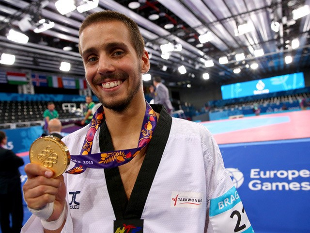 Rui Braganca of Portugal poses with his gold medal after winning the Men's Taekwondo -58kg final during day four of the Baku 2015 European Games at Crystal Hall on June 16, 2015