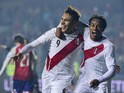 Peru's forward Paolo Guerrero celebrates with teammate Andre Carrillo after scoring against Paraguay during the Copa America third place football match in Concepcion, Chile on July 3, 2015