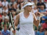 US player Bethanie Mattek-Sands celebrates beating Serbia's Ana Ivanovic in their women's singles second round match on day three of the 2015 Wimbledon Championships at The All England Tennis Club in Wimbledon, southwest London, on July 1, 2015