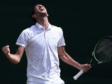 Britain's James Ward celebrates beating Czech Republic's Jiri Vesely during their men's singles second round match on day four of the 2015 Wimbledon Championships at The All England Tennis Club in Wimbledon, southwest London, on July 2, 2015