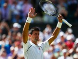 Novak Djokovic of Serbia reacts after winning his Gentlemen's Singles first round match against Philipp Kohlschreiber of Germany during day one of the Wimbledon Lawn Tennis Championships at the All England Lawn Tennis and Croquet Club on June 29, 2015