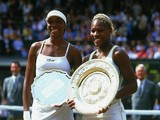 Wimbledon Ladies champion Serena Williams (right) of the USA poses with the winning trophy with runner-up and sister Venus Williams of the USA at the Wimbledon Lawn Tennis Championship held at the All England Lawn Tennis and Croquet Club in Wimbledon, Lon