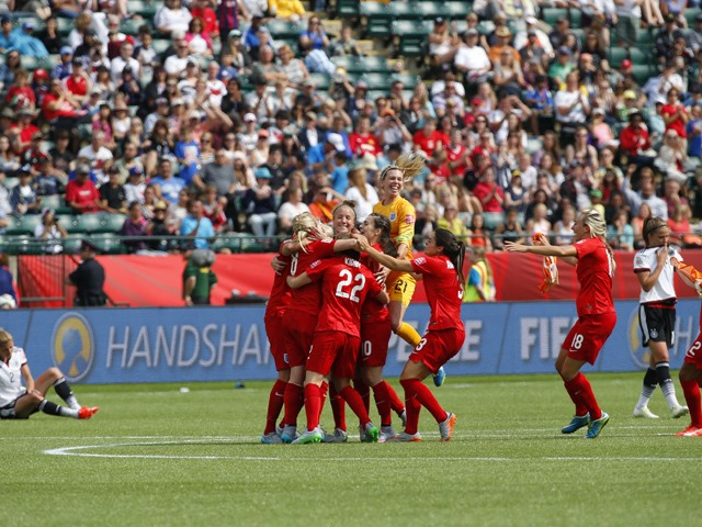 Team members from England their win over Germany during the FIFA Women's World Cup Canada 3rd Place Play-off match between England and Germany at Commonwealth Stadium on July 4, 2015