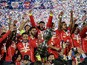 Chilean players celebrate with the trophy of the 2015 Copa America football championship, in Santiago, Chile, on July 4, 2015