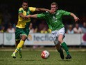 Josh Murphy of Norwich City battles with Aaron Taylor of Gorleston during the pre season friendly match between Gorleston and Norwich City at Gorleston football and social club on July 11, 2015