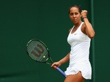 Madison Keys of the United States celebrates a point in her Ladies' Singles Fourth Round match against Olga Govortsova of Belarus during day seven of the Wimbledon Lawn Tennis Championships at the All England Lawn Tennis and Croquet Club on July 6, 2015