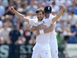 Mark Wood and James Anderson celebrate dismissing Nathan Lyon on day three of the First Test of The Ashes on July 10, 2015