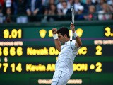 Serbia's Novak Djokovic celebrates winning the fourth set against South Africa's Kevin Anderson during their men's singles fourth round match on day seven of the 2015 Wimbledon Championships at The All England Tenni