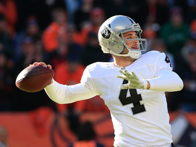 Quarterback Derek Carr #4 of the Oakland Raiders passes against the Denver Broncos during a game at Sports Authority Field at Mile High on December 28, 2014