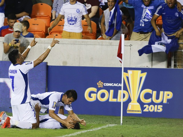 Dustin Corea, of El Salvador bottom, is mobbed by his teammates after scoring in the second half against Costa Rica at BBVA Compass Stadium on July 11, 2015