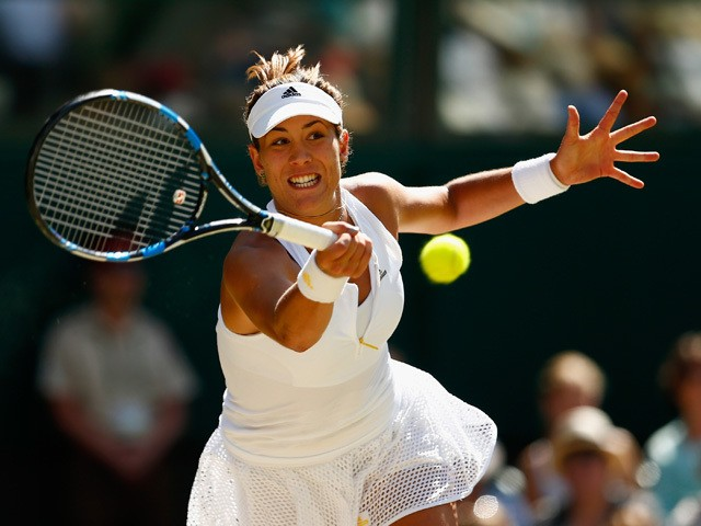 Garbine Muguruza of Spain plays forehand in the Final Of The Ladies' Singles against Serena Williams of the United States during day twelve of the Wimbledon Lawn Tennis Championships at the All England Lawn Tennis and Croquet Club on July 11, 2015