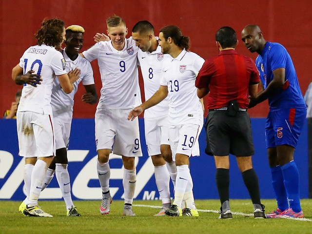 Teammates congratulate Clint Dempsey #8 of United States after he scored a goal as Frantz Bertin #6 of Haiti, right, disputes the call during the 2015 CONCACAF Gold Cup Group A match between United States and Haiti at Gillette Stadium on July 10, 2015