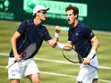 Andy Murray of Great Britain celebrates winning second set tie break with Jamie Murray of Great Britian against Nicolas Mahut and Jo-Wilfried Tsonga of France in the doubles match during Day Two of the World Group Quarter Final Davis Cup match between Gre