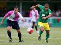 Louis Thompson of Norwich City moves away with the ball during the pre season friendly match between Hitchin Town and Norwich City at Top Field Stadium on July 14, 2015